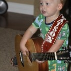 JACK LOVES THAT GUITAR WITH HIS CUSTOM STRAP!